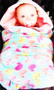 Un esempio su come vestire un neonato d'inverno se non fa molto freddo