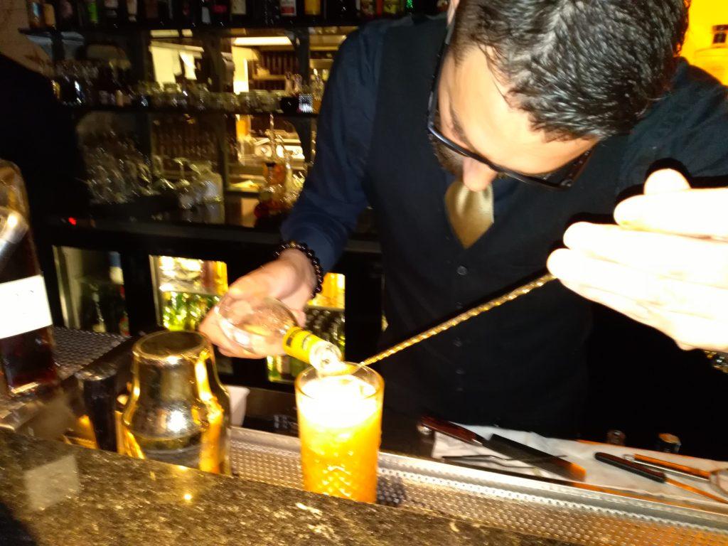 Preparing a cocktail with Italian amaro